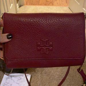 Tory Burch purpleish maroon clutch bag